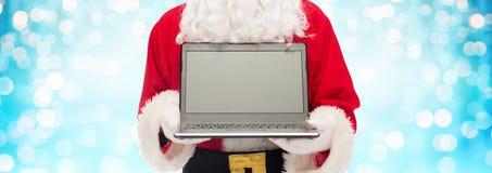 Slut upp av Santa Claus med bärbara datorn arkivfoto