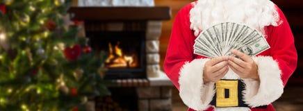 Slut upp av Santa Claus med dollarpengar Arkivfoto