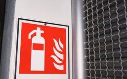 Slut upp av symbolet av brandsläckaren Royaltyfria Bilder