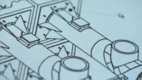 Slut upp av teckningen, konstruktionsplan materiel Den toppna närbildkameran för makroen på glidaren längs videoen, ser vi royaltyfria bilder