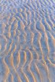 Slut upp av texturen för sandig strand Arkivbild