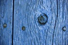 Slut upp av wood korn målade blått Arkivfoto