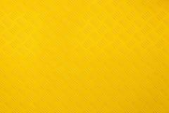Slut upp bakgrund och textur för gul metall arkivfoto