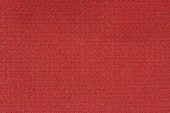 Slut upp bakgrundsmodell av röd textiltextur, textur för modell för abstrakt färgtextil netto Arkivfoto