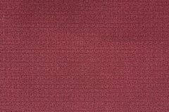 Slut upp bakgrundsmodell av röd textiltextur, textur för modell för abstrakt färgtextil netto Royaltyfri Bild