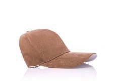 Slut upp den nya bruna baseballhatten beeing begreppskontaktdon fokuserar isolerad skjuten studion omgiven teknologiwhite Fotografering för Bildbyråer