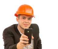 Slut upp den unga manliga teknikern Taking Mobile Picture Royaltyfri Foto