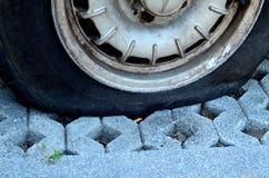 Slut upp det plana gummihjulet Fotografering för Bildbyråer