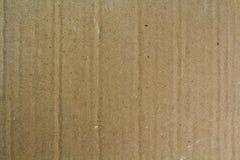 Slut upp gammalt kornigt dekorativt ljus - brunt tappningbuseark av textur eller bakgrund för lådapapppapper royaltyfri fotografi