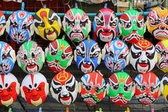 Slut upp kinesiska maskeringsgarneringar i kinesiska berömmar för nytt år Royaltyfri Fotografi