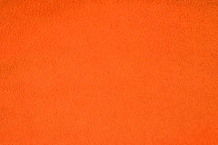 Slut upp orange ullbeklädnadtextur Bakgrund Arkivfoto