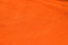 Slut upp orange ullbeklädnadtextur Bakgrund Royaltyfri Fotografi