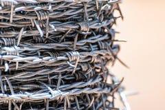 Slut upp på en rulle av försett med en hulling - tråd arkivbild