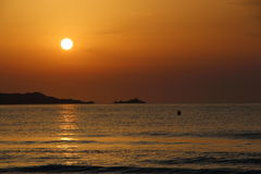 Slut upp på soluppgång arkivbild