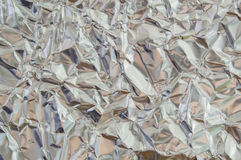 Slut upp silverbladbakgrundstextur med skrynkligt skinande Royaltyfri Fotografi