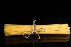 Slut upp spagettimörkerbakgrund Arkivfoto