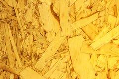 Slutet återanvände upp det komprimerade wood flisorbrädet Arkivbild