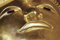 Slutet av guld- buddha vänder mot upp Royaltyfri Foto