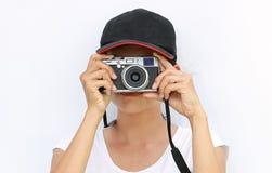 Slutet upp asiatiska kvinnor fotograferades p? vit bakgrund arkivbild