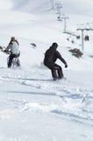 sluttande snowborder för cyklist royaltyfri bild