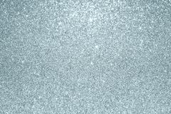 Slver glitter blur light effect texture particles background. Glittering silver or shining and sparkling snow bokeh lights for mod. Ern trendy Christmas festive Stock Photo