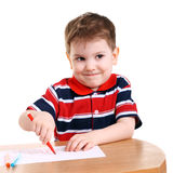 Sly. Cute little boy drawing isolated on white Stock Photography