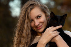 Sly,beautiful,playful,tricky,cunning, Caress And Held Black Cat.Girl Love Pets.Pet Is A Friend.Cat Is Friend To People. Royalty Free Stock Images