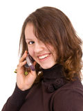 The sly conversation. Sly pretty girl talk by mobile phone and smile Royalty Free Stock Image