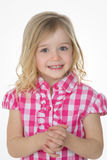 Sly cute girl on white background. Smiley child crosses his hands and looks at the camera Royalty Free Stock Image