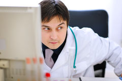 Sly doctor planned something wrong Stock Photography