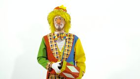 Sly funny clown showing bright box which is clear inside stock footage