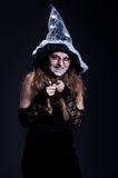 Sly laughing witch Royalty Free Stock Images