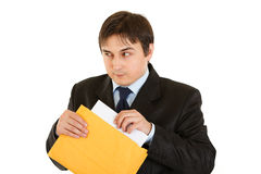 Sly modern businessman sending urgent letter. Isolated on white Royalty Free Stock Image