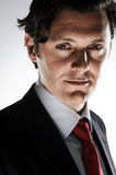 Sly oil tycoon. Dramatic lighting on a caucasian man in a business suit to convey a deceitful side Stock Photos