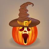 Sly pumpkin in a witch hat for Halloween Royalty Free Stock Photo