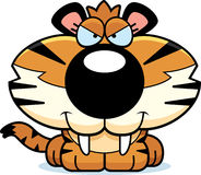 Sly Saber-Toothed Tiger. A cartoon illustration of a saber-toothed tiger cub with a sly expression Royalty Free Stock Photos