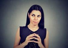 Sly, scheming woman plotting something Stock Photo