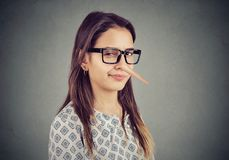 Sly tricky young woman liar royalty free stock photos