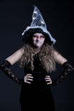 Sly witch over dark background Royalty Free Stock Photography