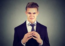 Sly young business man looking at camera Royalty Free Stock Photography