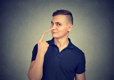 Sly man with long nose. Liar concept. royalty free stock photos