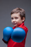 Slyly smiling young boxer posing looking at camera Royalty Free Stock Images
