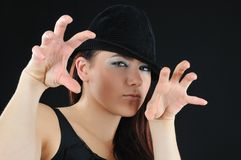Slyness girl. In black hat Royalty Free Stock Photography