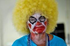 Smältande makeup på en kvinnaclown Arkivfoto