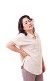 Smärtar åldrigt kvinnalidande för mitt från tillbaka arkivbild