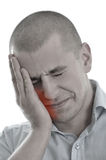smärtar den head holdingen isolerade män tanden arkivfoton