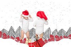 Små barn i santa hattar arkivfoton