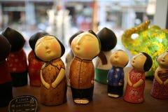 Små dockor i leksakdiversehandel Royaltyfria Foton
