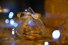 Små guld- favörer för godis royaltyfria foton