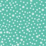 Små gulliga blommor på grön rutig bakgrund stock illustrationer